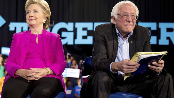 In this Nov. 3, 2016 file photo, Democratic presidential candidate Hillary Clinton and Sen. Bernie Sanders, D-Vt., appear at a rally at Coastal Credit Union Music Park at Walnut Creek in Raleigh, N.C. The tension between supporters of Bernie Sanders and Hillary Clinton resurfaced on Tuesday after the Vermont senator announced his second run for the White House.