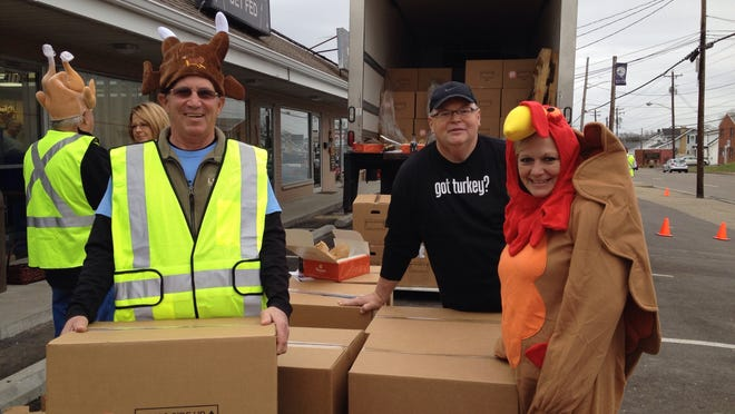 John Rottinghaus, left, of Union, LifeLine Ministries founder Chris Caddell and Mary Seniours, of Fort Wright, are ready to distribute Thanksgiving food boxes on Sunday, Nov. 23.
