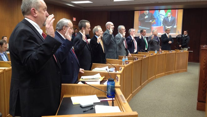 Green Bay aldermen, shown taking the oath of office last spring, trimmed spending in several areas to keep property taxes from increasing in the 2015 budget.