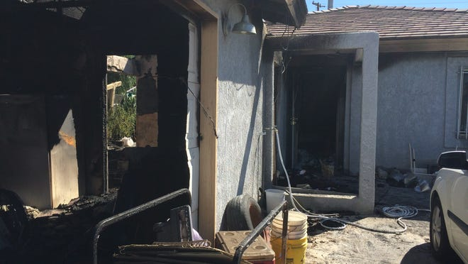 One woman died and three other adults were hospitalized when a fire broke out in this home on Sumac Road in Desert Hot Springs around 1:20 a.m. Friday.