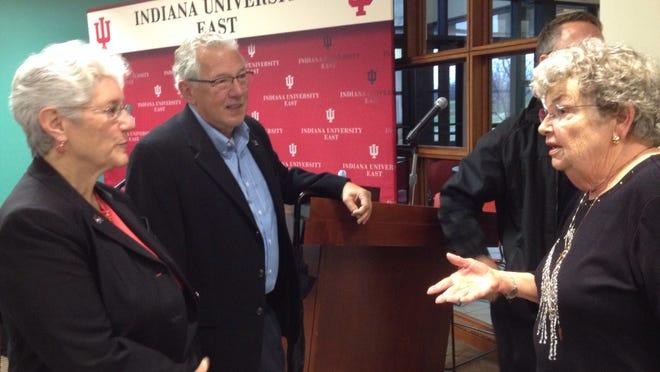 State Rep. Tom Saunders talks with Indiana University East Chancellor Kathy Cruz-Uribe, left, and Barbara Sha Cox of Richmond before a 2014 IU East Alumni Association Legislative Forum.