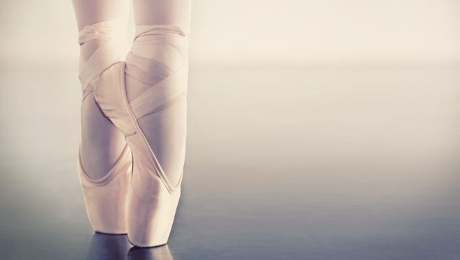 "Cropped closeup shot of a ballerina's feet ""en pointe"""