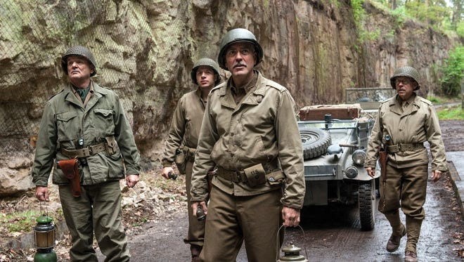 Bill Murray, left, Sam Epstein, George Clooney and Bob Balaban in a scene from 'Monuments Men.'