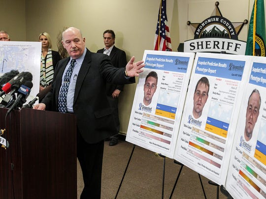 Snohomish County Cold Case Detective Jim Scharf, left, presents new images rendered using phenotype technology of a potential suspect in the unsolved case of the 1987 double homicide of Jay Cook and Tanya Van Cuylenborg.