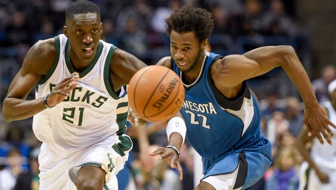 Milwaukee Bucks guard Tony Snell  steals the ball from Minnesota Timberwolves forward Andrew Wiggins. Snell scored 19 points to help the Bucks beat the Timberwolves, 102-95.