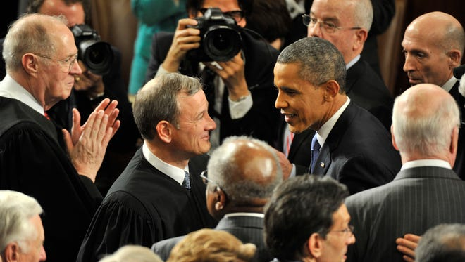 President Obama and Supreme Court Chief Justice John Roberts greet each other at last year's State of the Union Address.