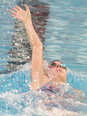 McMurry senior Robyn Remschel swims the backstroke