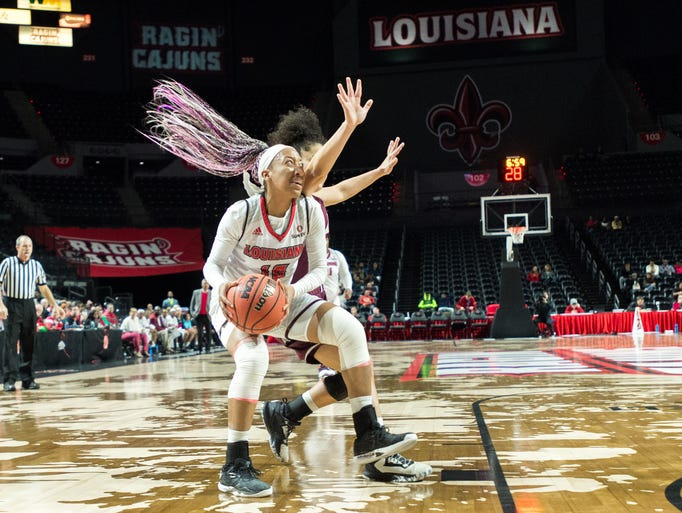 Troi Swain drives to the basket as the Cajuns take