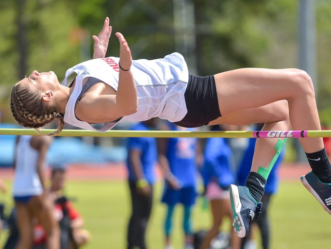 Lindsey Harmon competes in the womens high jump at
