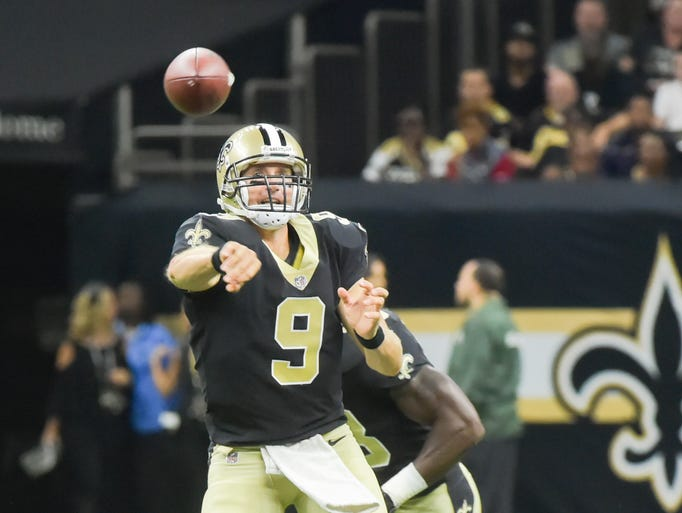 Drew Brees throws a pass as The New Orleans Saints
