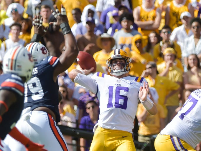 Quarterback Danny Etling throws a pass as the LSU Tigers