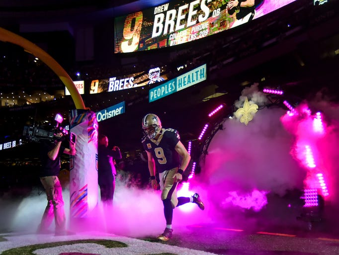 Saints quarterback Drew Brees takes the field as the