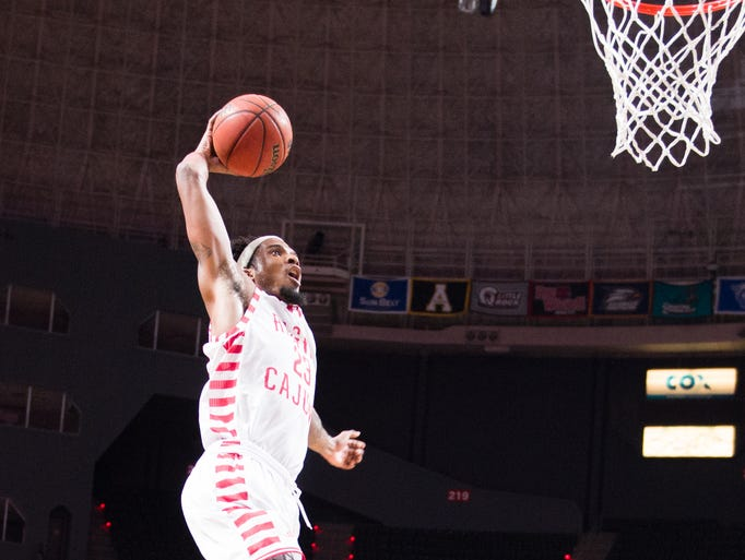 Jakeenan Gant dunks the ball as Lousianas Ragin Cajuns