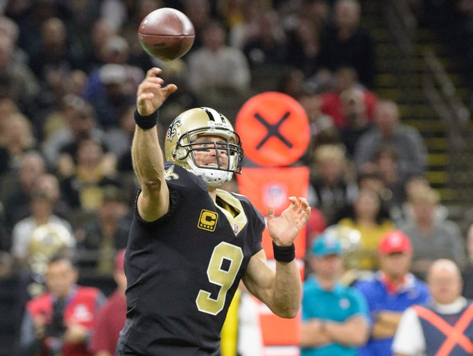 Saints quarterback Drew Brees throws a pass as The