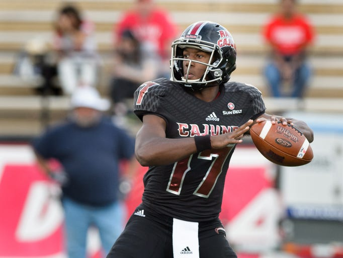 Cajuns quarterback Levi Lewis drops back to pass as
