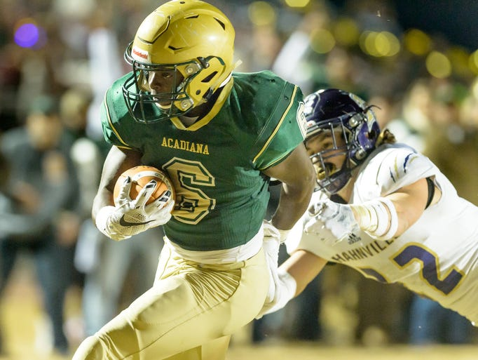 Rams runningback Regrick Francis runs the ball as Acadiana