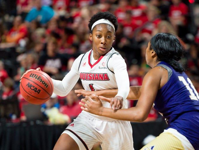 Kimberly Burton drives to the basket as The Louisiana