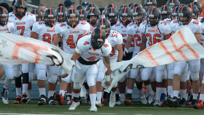 The Dearborn football team takes the field Sept. 26, 2014.