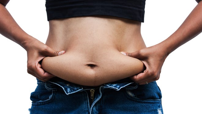 Body fat, especially belly fat, is a more important health indicator than weight, experts say. Body fat, especially belly fat, is a more important health indicator than weight, experts say.