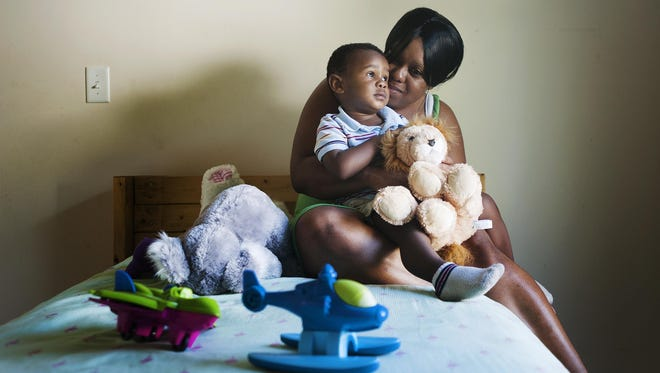 Tracey Mcghee and her 2-year-old son, Raequan, have been living in Asheville since March after fleeing an abusive relationship. They have found support from programs in Buncombe County, including Helpmate, Homeward Bound and the organization Asheville Buncombe Community Christian Ministries.