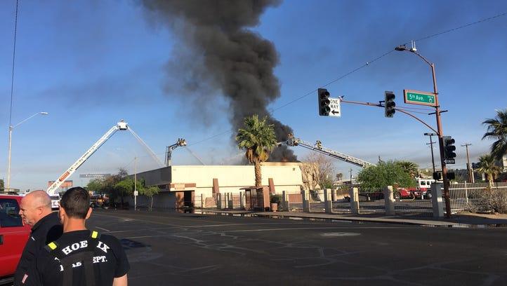 Fire burns vacant building in downtown Phoenix on Van Buren Street