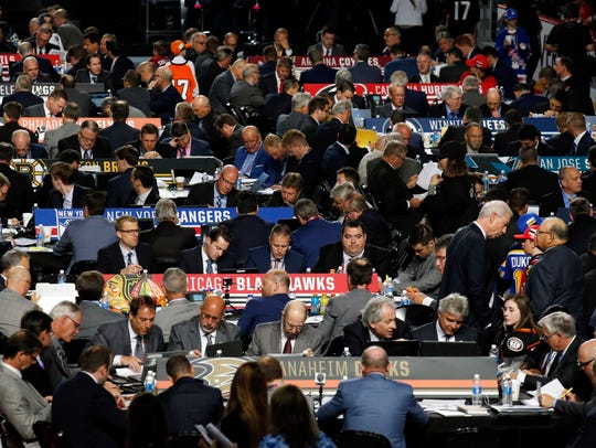 Representatives from NHL hockey teams begin their work