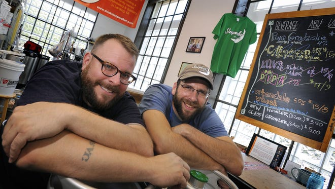 Jeremy Sprague, left, and Matt Jason, right, pictured at Sleepwalker Spirits and Ale in the Allen Market Place in 2015. The company is on hiatus since Jason left in August. Sprague plans to reopen the business as a micropub.
