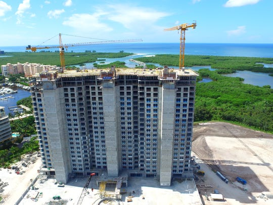 The first residential tower at Kalea Bay topped off on Sept. 30 and is slated for completion in fall 2017.