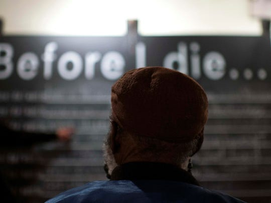 A guest views the #BeforeIDie wall at last year's event at Perkins Center for the Arts in Collingswood. The event inspires discussions about end-of-life.