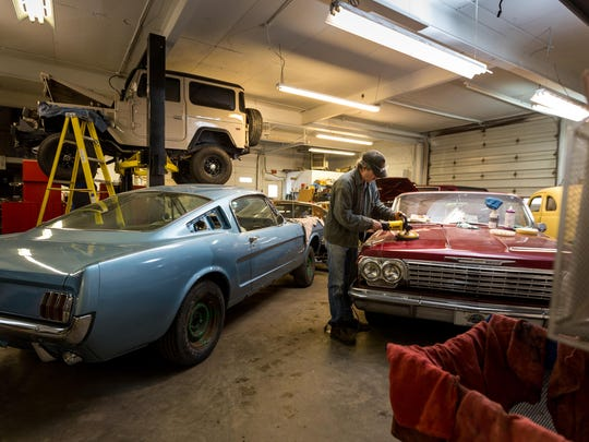 Mike Steines, a mechanic that has been with Kuyoth's Klassics for 30 years, polishes a classic car inside the body shop in Stratford, Wis.
