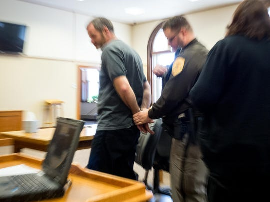 Kenneth Conrad is handcuffed by Deputy Joseph LeBreck after he was sentenced for first-degree sexual assault on March 15, 2017 in the Adams County Courthouse in Friendship, Wis.
