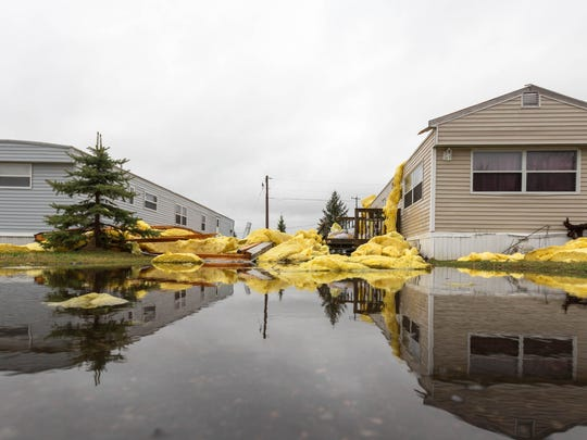 Strong winds followed by thunder and lighting, causes damage to a manufactured housing community called Boardwalk, on the north side of Marshfield, Wis. on April 10, 2017
