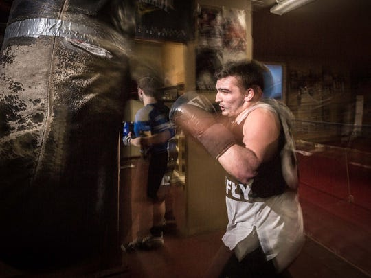 Noah Sconzert, 21, an amateur boxer at Gust Gym Boxing, warms up before sparring during practice on March 7, 2017 in Marshfield, Wis.