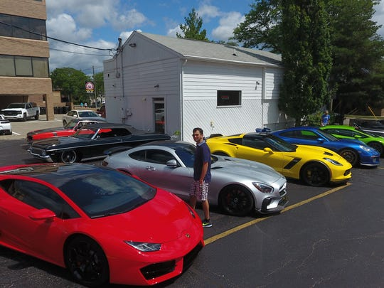 High-end sports cars are lined up in the Premium Motors parking lot in Birmingham.
