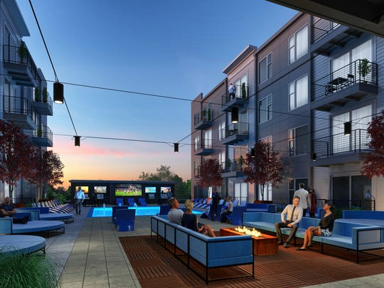 River Haus, a luxury apartment and mixed-use building, will include a community courtyard with fire pits, bar, lounge areas, grilling station and pool.