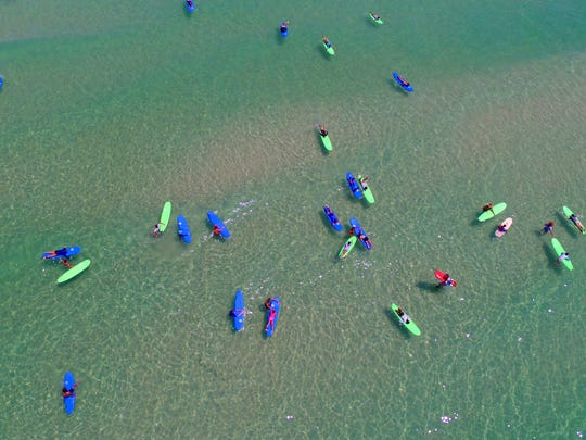 Kids learn to surf at a Waterboyz surfing camp. Waterboyz