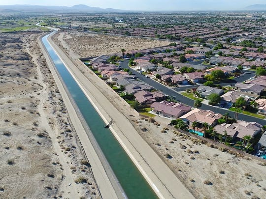 Water flows through the Coachella branch of the All-American Canal, bringing water from the Imperial Valley to the Coachella Valley, near the Shadow Hills home development in north Indio on June 13, 2018.