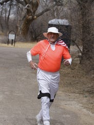 Ronnie White, of Waterflow, jogs down the final stretch
