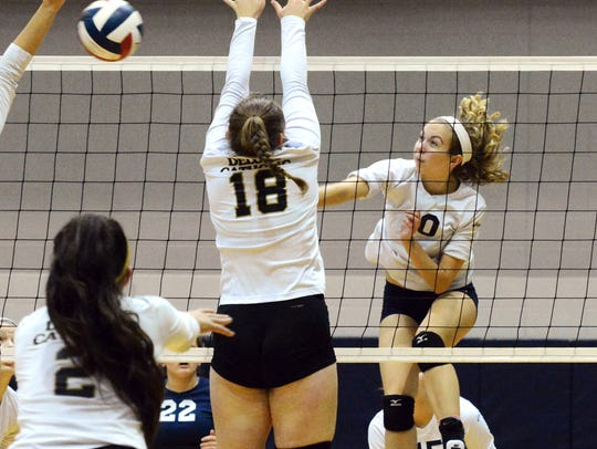 West York's Kate Tate slams a shot past Delone's Maggie
