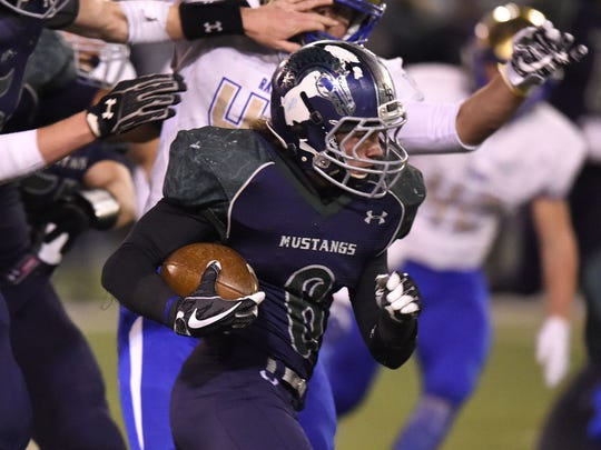Damonte's Ryon Hurley carries the ball against Reed on Nov. 17, 2017.