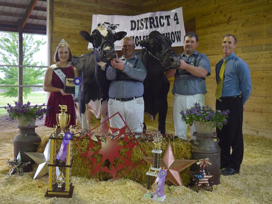 District 4 Grand Champion and Reserve Grand Champion of the Open Show (from left) WHA Princess Courtney Moser, Grand Champion OCD Braxton Charlee,Noah Bilz, Reserve Grand Champion is Sandy-Valley Atwd Blacky, Michael Duckett, Judge Roger Turner.