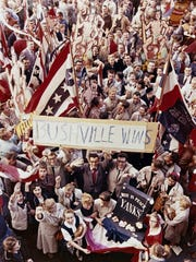 """Color photo of the celebration of the Milwaukee Braves World Series victory in 1957. Known as the """"Bushville Nine"""" photo."""