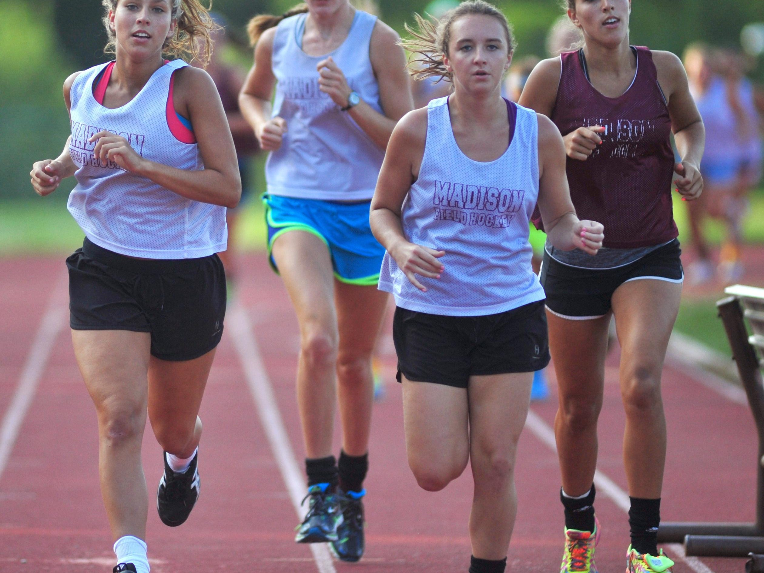 Captains lead the team on a run before practice starts: seniors Kaitlyn deSilva, Caroline Turnbull, Emma Ticknor and Amanda daSilva. The Madison field hockey team practices Monday night at the high school, Madison, NJ. Monday, Aug. 24, 2015. Special to NJ Press Media/Karen Mancinelli/Daily Record MOR field hockey preview