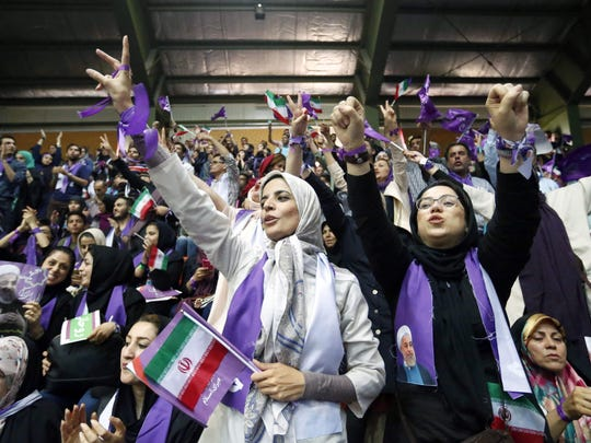 Supporters of Iranian President Hassan Rouhani in the