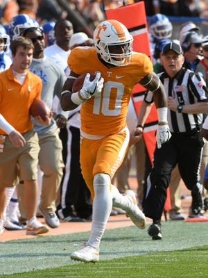 Tennessee wide receiver Tyler Byrd runs after catching a pass during the first half against Kentucky on Saturday at Neyland Stadium.