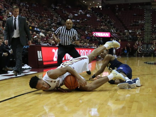 C.J. Walker (2) dives for a loose ball during Florida