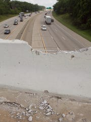 Concrete crumbles onto the Flint Road overpass over