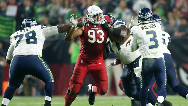 Arizona Cardinals DE Calais Campbell pressures Seattle Seahawks QB Russell Wilson during the third quarter in NFL action at University of Phoenix Stadium in Glendale on Dec. 21, 2014.
