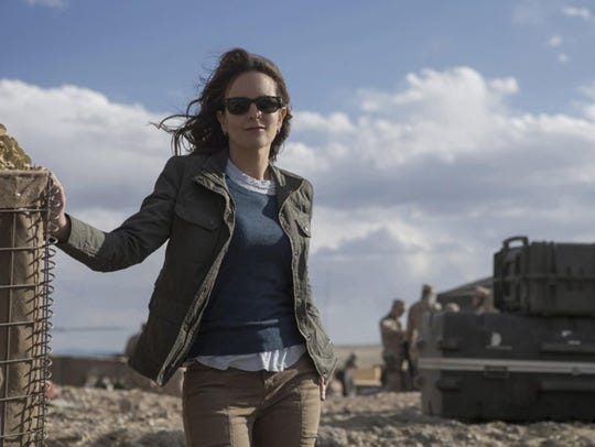"""Tina Fey stars in """"Whiskey Tango Foxtrot,"""" which opens"""