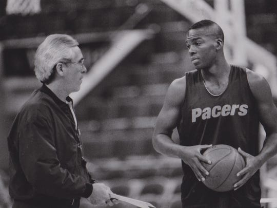 Pacers coach Bob Hill, left, talks to Chuck Person.